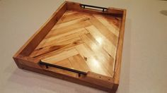 This is a herringbone patterned serving tray made from pallet wood.