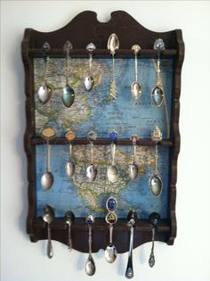 """""""Updated"""" an old spoon rack by using decoupage and scraps of an old map and then some brown crackle paint on the rest!"""