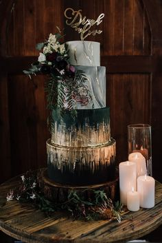 Modern jewel toned wedding cake with marble detail, gold foil, purple flowers and 'Drunk in Love' topper | Chantelle Stagg Photography