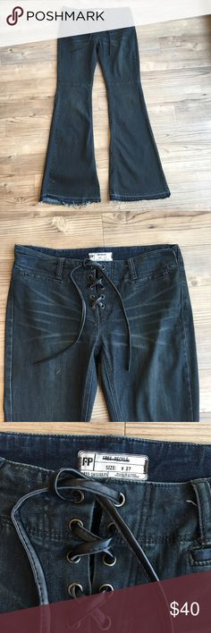 """Free People Flared Retro Dyed Jeans NWOT Free People Flared Retro Dyed Jeans Women's Size 27 See Details Below  Low Rise 8"""" Inseam 34"""" Waist 17"""" Flat Flare Bottoms Lace up Front Closure 2 Back Pockets 2 Small Front Pockets Cotton, Poly, Spandex Blend The jeans are a dyed dark color - read care for label before washing Very retro 70's style jeans Thanks for stopping by my store! I make every effort to describe my items in detail, specifically any flaws or issues with my items along with any…"""