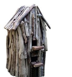 """Rustic birdhouse with coastal flair and individual character Driftwood bird house offers a cozy nest spot and roost for cool nights. Single compartment with two entries measuring 1.25""""-1.5"""". Ideal for"""
