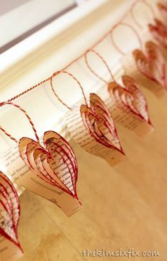 Step by step tutorial to create paper hearts out of old book page and then dip them in to glitter to make them shimmer! Turn old book pages into a darling heart garland accented with red glitter to give it some sparkle. Valentines Day Decorations, Valentine Day Crafts, Be My Valentine, Holiday Crafts, Christmas Crafts, Heart Decorations, Farewell Decorations, Valentines Hearts, Origami Christmas