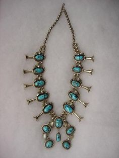1965-70 sterling silver and gem quality Persian turquoise Navajo squash blossom necklace.  Strung with hand-made 8mm sterling silver beads.  Hook & eye closure