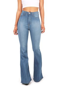 High waist fitted denim pants with flared bottoms. Faux pockets on the front with button and zip fly. Comfortable stretchy material. Looks great with a cropped tee or tank. For a dressier look tuck in