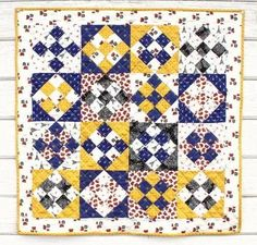 Journey to Europe without leaving your quilt studio and create a classic mini quilt inspired by the landmarks of France and England with this Small Wonders Nine Patch Quilt. Made using the simple nine patch block, this mini quilt is a fantastic proje Scrappy Quilts, Mini Quilts, Baby Quilts, Jelly Roll Quilt Patterns, Quilt Patterns Free, Quilting Projects, Quilting Designs, Quilting Ideas, Quilting Board