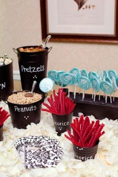 easy containers for candy bar, cheap buckets and chalkboard spray paint.