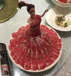 Dressed to impressed: One of the most unusual offerings is this doll covered in slices of ...