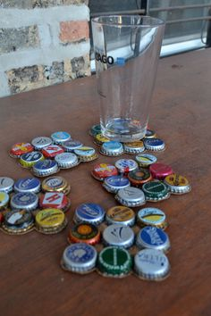 Bottlecap Coasters by BrewedCrafts on Etsy, $17.00.... bottom is thin corkboard a variety of caps are used