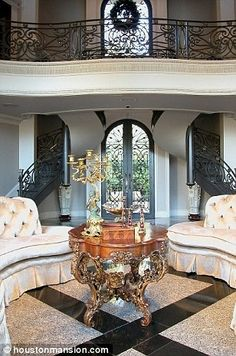 Grandiose: The hallway boasts sweeping staircases and ornate iron banisters on a balcony