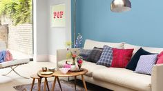 Consider this blue for chimney breast (Dulux Nordic Blue) with pale blue walls elsewhere for the living room.