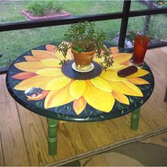 Wooden dining table from a garage sell. I cut the legs to coffee table height and painted a sunflower on top. Its now on my back porch for holding a glass of tea or a color book for the grands. Hand Painted Chairs, Painted Coffee Tables, Funky Painted Furniture, Paint Furniture, Repurposed Furniture, Furniture Projects, Furniture Makeover, Cool Furniture, Do It Yourself Home