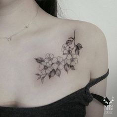 Blackwork cherry blossoms on the chest. Tattoo artist: Zihwa: