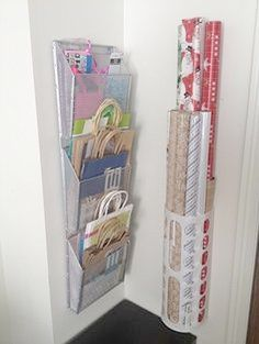 A mail organizer and a grocery bag keeper! That's all it takes to make this easy and affordable wall-mounted gift wrap center.
