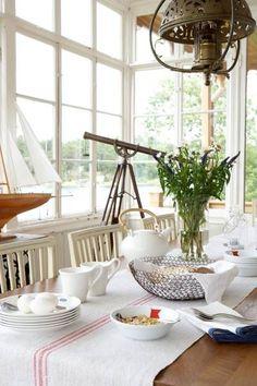 Large windows, hanging lamp, simple linen table runner