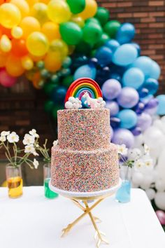 Rainbow birthday cake that is just to die for! Photographer : Becky Kimball Read More on SMP: http://www.stylemepretty.com/living/2017/01/06/rainbow-inspired-birthday-party-complete-with-unicorns/