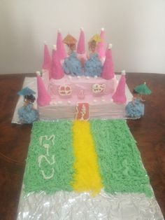 Minu's 4th birthday, castles and dolls cakes.  4 mini dolls, marshamallows, wafers and cones and colored coconut makes this cake easy.