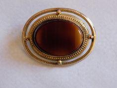 Vintage gold tone brown / amber-like oval brooch by joegems66