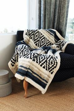 This knit blanket has been inspired by the iconic striped and geometric patterns symbolic of the blankets in today's culture. Find this Two of Wands pattern and more knitting inspiration at LoveKnitting.Com.