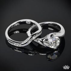 """beautiful 0.775 ct G VS2 A CUT ABOVE® Hearts and Arrows Super Ideal Round Cut Diamond Set in our 18k White Gold """"Iris"""" Solitaire Engagement Ring. Expertly designed, the """"Iris"""" Solitaire Wedding Set is ideal for the lady who likes both of both worlds. The """"Iris"""" Solitaire Engagement Ring has a beautifully simple bypass design, while the """"Iris"""" Diamond Wedding Ring adds the flair with 20 A CUT ABOVE® Hearts and Arrows Diamond Melee."""