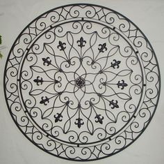 Round wrought iron wall art.