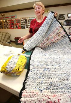 Brenda Mayfield shows a plastic grocery store bag mat and pillow that she crocheted for the homeless at the Trinity Lutheran Church in Annis...