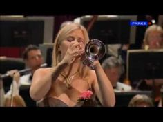 Allison Balsom, playing the 1st movment of the Haydn Concerto in Eb. I do believe I've seen her play:) and I do want that Eb trumpet sound...