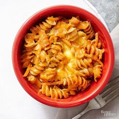 All you need to make this pasta dish: cayenne pepper sauce, shredded carrots, American cheese, ranch dressing mix, and pasta./