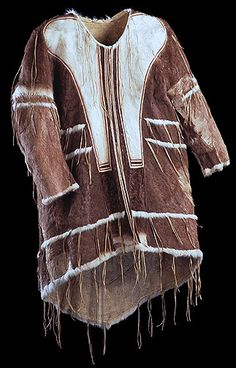 Inuit dance clothing - Man's hoodless dance coat Copper Inuit (Kilusiktormiut), Coronation Gulf, Northwest Territories, 1914-1916 Caribou skin, sealskin, sinew.