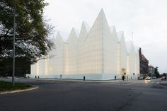The Philharmonic Hall designed by Barozzi/Veiga in Szczecin, Poland, is a white, austere volume, with the serial modulation of the roof as the only expressive element, that conceals the rich decoration of the main hall.