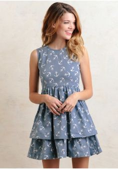 This oh-so-cute, light-blue cotton chambray dress features a white anchor print allover with a tiered hemline and voluminous slip lining. Perfected with a coated finish and an exposed back zipper...