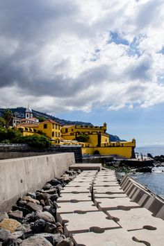 Sao Tiago Fort by chriswtaylor  trees sky beach travel clouds architecture path building green fortress fort Europe Portugal Funchal
