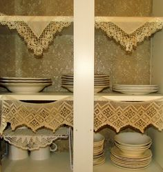Miss Gracie's cabinet.  Lovely vintage lace and white dishes (from a series of photos)