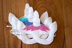 Beautiful handmade soft felt Unicorn Mask. Perfect for dress-ups and inspiring imaginative play.  Masks are crafted, cut and lovingly embellished