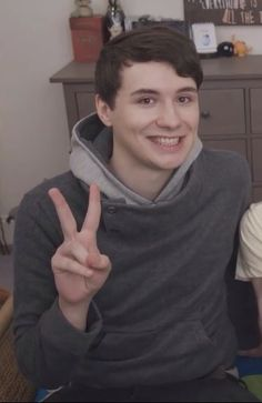 Why do I feel like Dan's secretly dat dreaming about stealing all of our souls while taking this picture