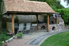 Outdoor kitchen and dining area with Pizza oven