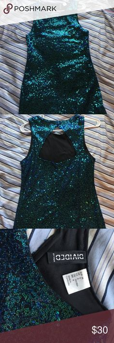 Sequined mini dress! 👗 Beautiful sequined mini dress! This dress was worn once for a few hours but doesn't even look like it! It will definitely make you pop out and catch eyes anywhere you go! Sadly it doesn't fit me anymore so i can never wear it like i should, so it definitely needs a home where someone can take advantage of its beauty!😍 Bundle with another item and save! 💚💙 Divided Dresses