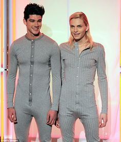 Androgynous model Andrej Pejic (left) wears a revealing pinstriped onesie on the catwalk at Jean Paul Gaultier fashion show. (Kinda weird)