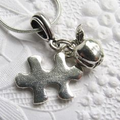 Autism awareness, puzzle piece charm, silver pewter apple, special education teacher gift, back to school. $24.00, via Etsy.