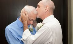 Same-sex couple Randy Faria and Michael Thomas-Faria kiss as they wed during the first day of legal same-sex marriage in New York state on July 24, 2011, in New York City.  Photo by Bennett Raglin/WireImage