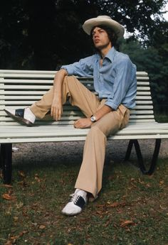 Mick Jagger sits on a park bench, sporting a panama hat for this 1973 photo by Anwar Hussein in Vienna, Austria.