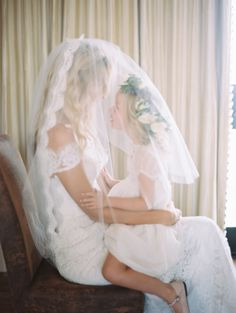 Adorable bride + daughter moment: http://www.stylemepretty.com/2015/12/29/dreamy-malibu-fall-estate-wedding/ | Photography: Kurt Boomer - http://kurtboomerphoto.com/