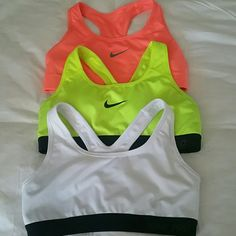3 Small Nike Sports Bras 3 Small Nike Sports Bras, worn only about once each. Just too small Nike Tops