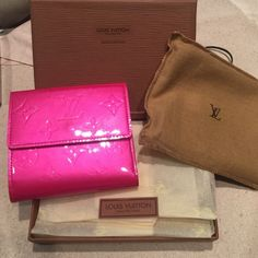 Louis Vuitton wallet Monogram embossed Fuchsia patent leather wallet- snap closure on both sides, one coin compartment, 4 card slots, 2 flat pockets, one coin pocket, pink leather lining,gold tone hardware.excellent condition.comes in original box, with tissue , tags & dust bag Louis Vuitton Bags Wallets