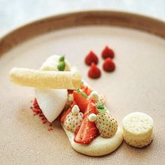 Tasty little white strawberry dessert with vanilla parfait tiny lemon meringues and a strawberry & spearmint soup by @boyfromdevon - Food Plating