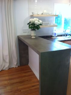 2 of 5 parson's style breakfast bar made out of layered plywood with an Ardex concrete product overlay and sealer. I went for a more artesian look by showing the trowel marks but you could make this product look seamless.