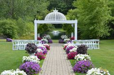 A summer aisle loaded with flowers at Apple Blossom Chapel and Gardens.