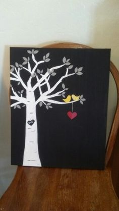 I painted the canvas black. Then I free handed the tree. Cut out leaves, the birds and a heart. Hung the heart on string. Glued them all on and sprayed it with a clear coat.