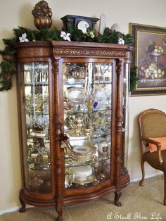 Table Top Tuesday - Redoing China Cabinet - A Stroll Thru Life Curio Cabinet Decor, Crockery Cabinet, Antique China Cabinets, China Cabinet Display, Shelf Design, Cabinet Design, Marble Top Dresser, Displaying Crystals, Antique Bookcase