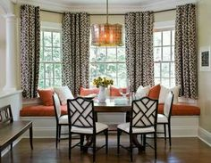Love the bay window seat, chairs, curtains, and colors!