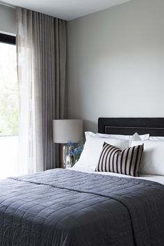 Soft yet crisp guest bedroom also juxtaposes warm and cool, light and dark palette. by Matthew Barnes Interior Design.